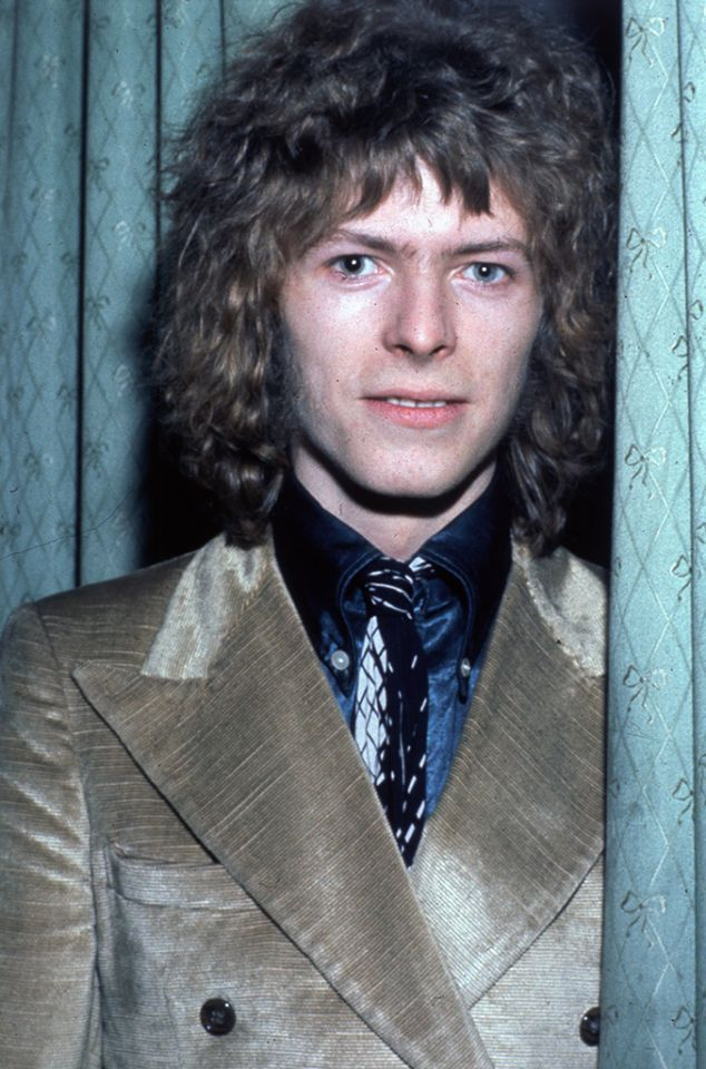 David Bowie rocks a long shag at the Cafe Royal, London circa 1970, during his 'Man Who Sold the World' era.