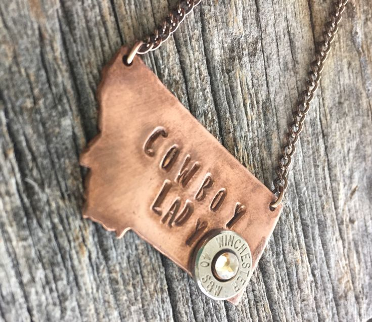 MONTANA STATE PENDANT NECKLACE: Montana Jewelry - Custom State Jewelry - Stamped Jewelry - Cowboy Lady - Copper State Pendant - 40 Smith and Wesson - Bullet Jewelry by WhiskeyDeltaCo on Etsy https://www.etsy.com/listing/487365233/state-pendant-necklace-montana-jewelry