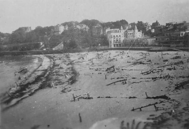 D-Day_Beach_With_Obstacles_And_Debris_Normandy_June_1944 - WAR HISTORY ONLINE