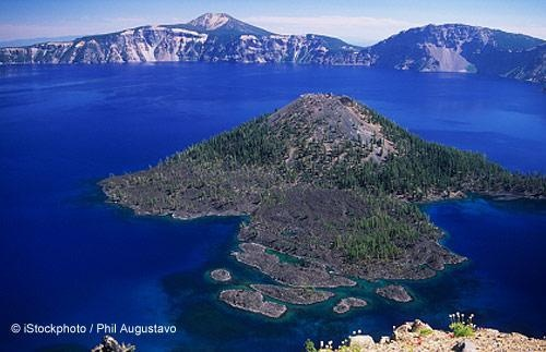 You won't find Harry Potter in Wizard Island, but that doesn't make it less enchanting! Created by the stratovolcano Mount Mazama, this volcanic cinder cone in Crater Lake National Park, Oregon is definitely an enthralling place.: Crater Lake