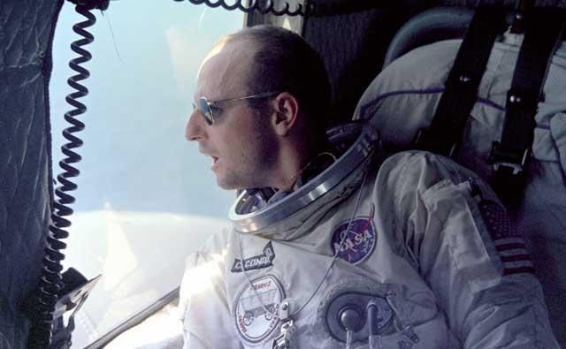 Pete Conrad looking out of a recovery helicopter after Gemini 5 mission