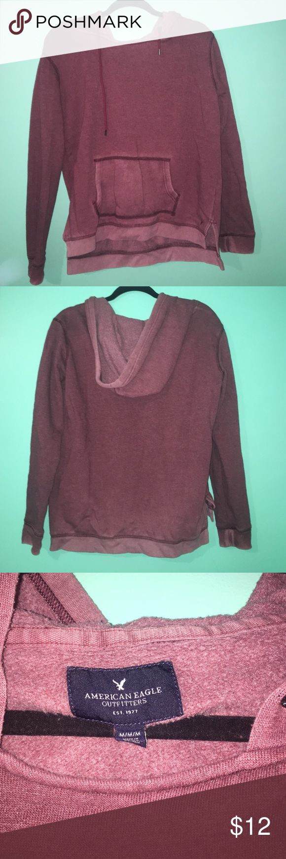 American Eagle Sweatshirt Maroon sweatshirt with: strings, front pocket, & a hood. Worn less than a handful of times. American Eagle Outfitters Tops Sweatshirts & Hoodies