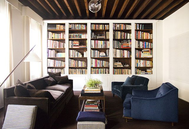 shelving. beams. and blue velvet chairs.
