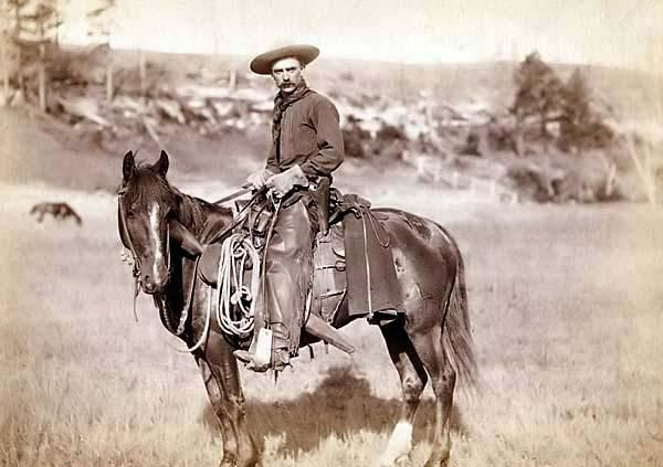 The photo shows the traditional dress and gear of an authentic old west cowboy. It was taken in 1888 by Grabill, John C. H., photographer.