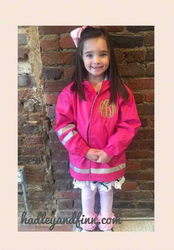 Monogrammed Rain Jacket for Toddlers, Children, and Youth. Sizes: 2T, 3T, 4, 5, 6, 7, S(7/8), M(10/12), L(14/16), XL(18/20)  Colors: Hot Pink, Coral, Aqua, Wave (Turquoise), Dark Yellow with Navy Trim, and Youth Only True Navy with Yellow Trim.  Wind & waterproof New Englander Polyurethane bonded to a woven backing to provide additional fabric strength. Lined with mesh for air-flow circulation and taffeta nylon in sleeves for easy on/off. Elastic gathering at hoo...