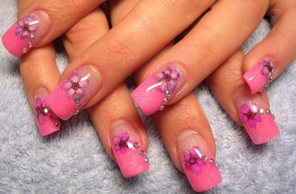 Pink sparkly French tip with purple flowers and rhinestones