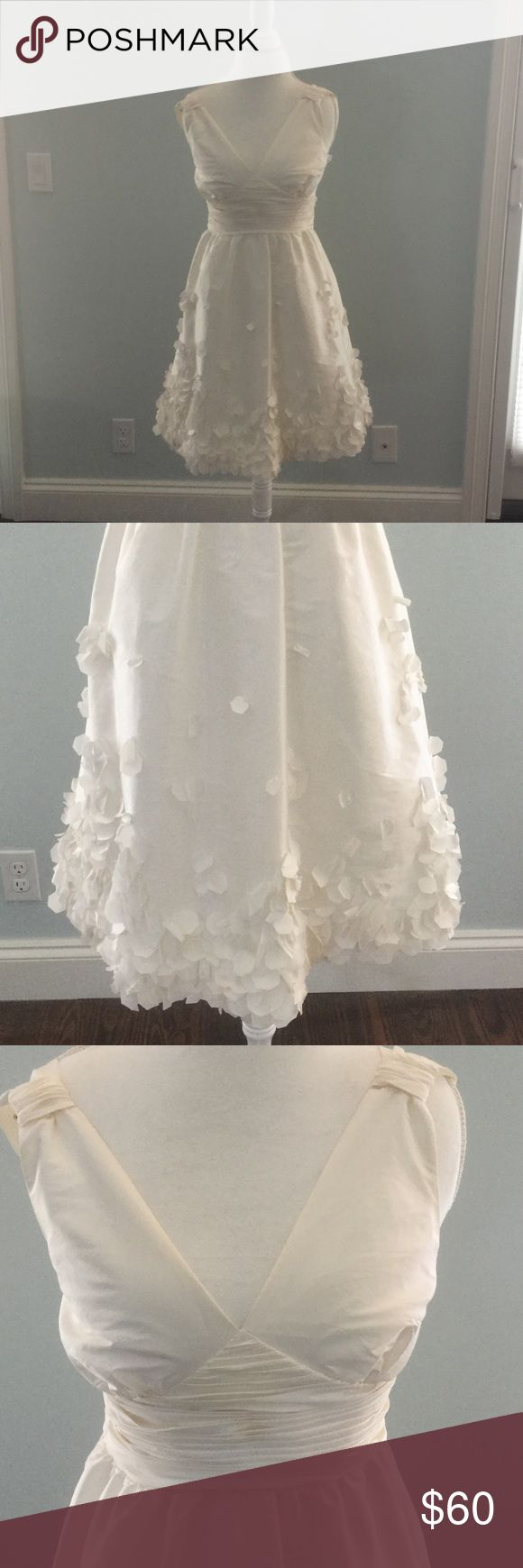 Calvin Klein dress Ivory with soft petals and tiny pearls sewn around the skirt area. Very soft and light. Only worn once on Easter. Calvin Klein Dresses Midi