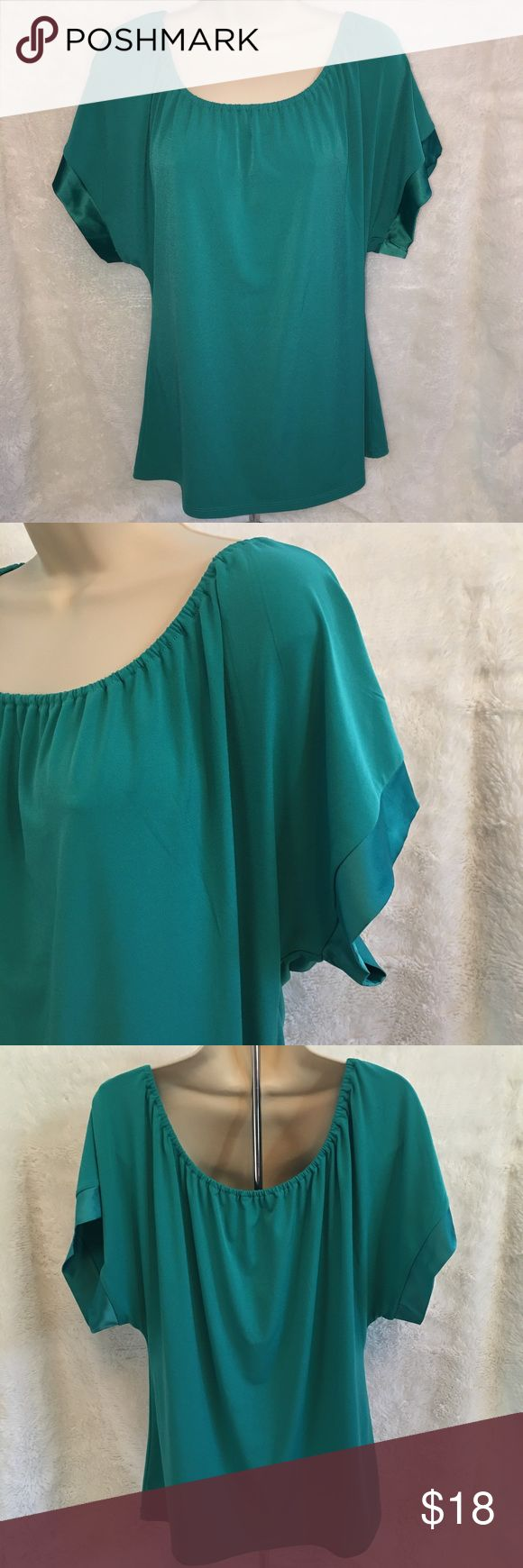 Express Blouse Nice scoop neck top in EUC. Satin trim on the sleeve. Made from a polyester/spandex blend. Express Tops Blouses