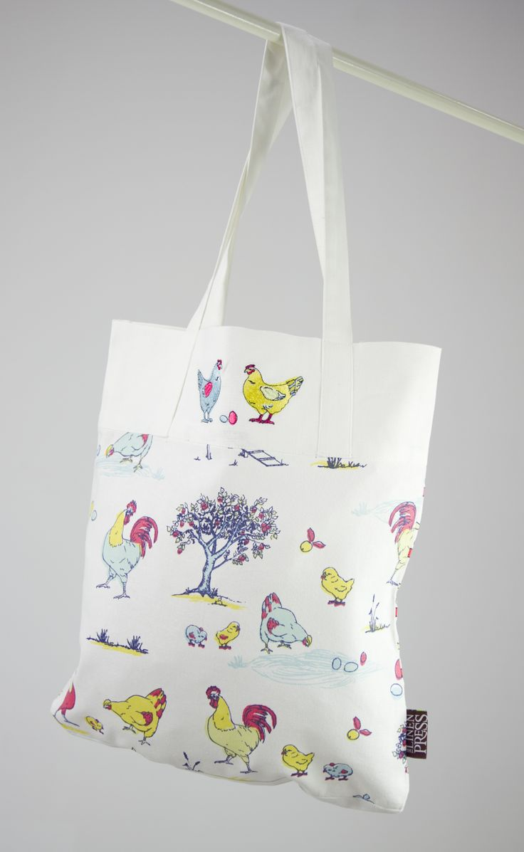 Australian Certified Organic cotton shopper bag. Designed in Australia. Printed with water based dyes. Machine embroidered chickens and repeat print one side with apple print on reverse. Design features chickens, eggs and farmyard scene.  #gift #chickens #farmyard #certifiedorganic