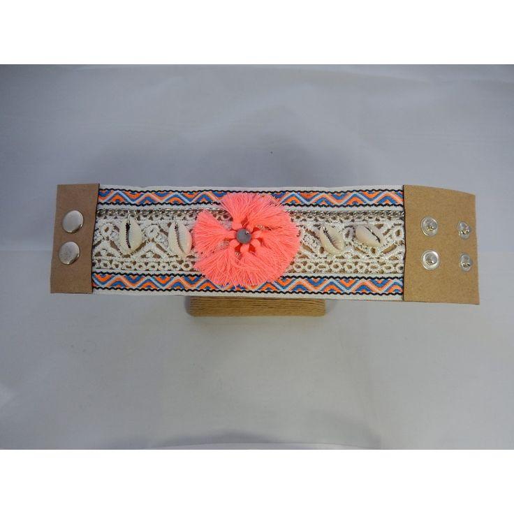 Manchette ethnique coquillage-rose .  Longueur: 23 cm ,système d'attache pression 2 positions.