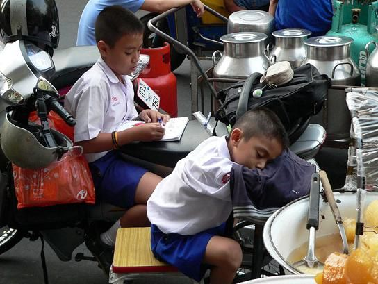 Young Thai School Kids - One learning to read and one leaning to sleep