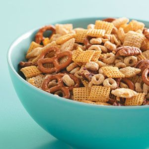 Maple-Glazed Snack Mix     2 cups Corn Chex     2 cups Rice Chex     2 cups Honey-Nut Cheerios     1 cup miniature pretzels     1/2 cup pecan halves, coarsely chopped     1/3 cup maple syrup     1 tablespoon butter     1 teaspoon vanilla extract From TasteOfHome.com