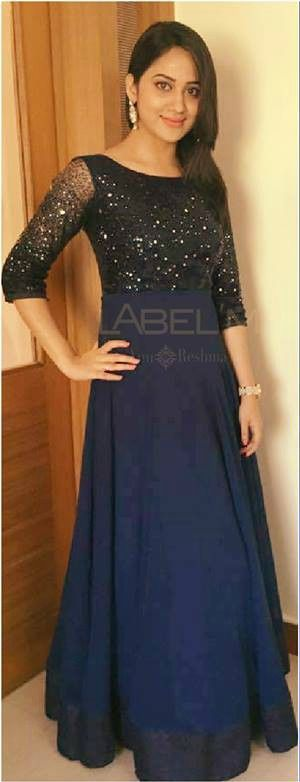 Mia George in navy blue gown costume courtsey : label m