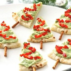 Chirstmas trees appetizers Pita, guacamole, diced tomatoes, pretzel stick
