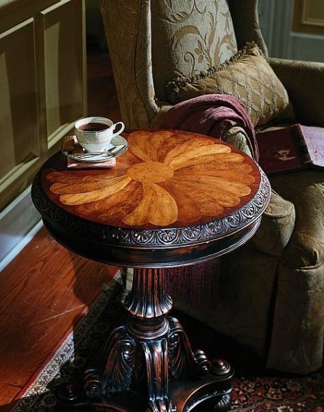 "Decorative ""fanned"" veneer top. Birch Solids with Oak Burl, Rosewood and Cherry Veneers; Black Rub-Through Finish."