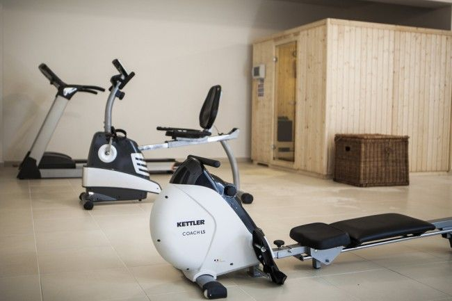 Mini-gym, sauna, Hamam or steam room and a large flat screen T.V. & home entertainment system at the basement area