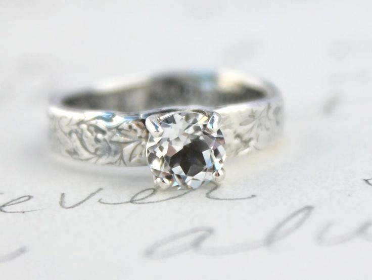 white topaz engagement ring . recycled silver topaz prong set ring . custom size . engraved secret message. $278.00, via Etsy.