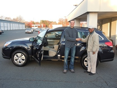 Folger Subaru Sales Consultant Bill Barber with Mr. Delaney and his 2002 Subaru Legacy Outback crossover SUV!