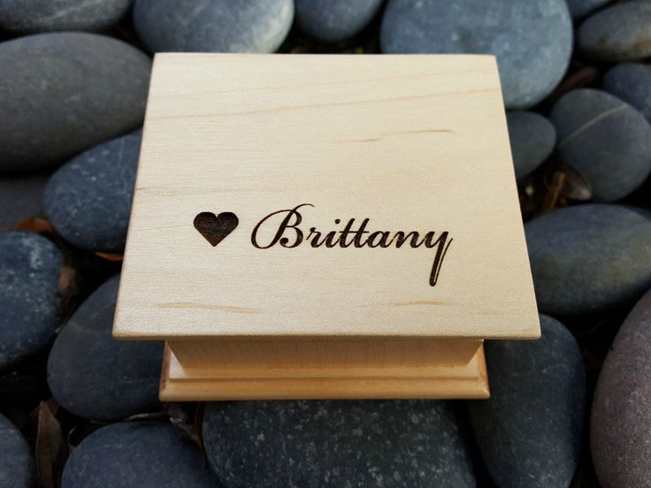 Wooden music box with and heart image and your name on top. You can pick your choice of color and song and also add a personalized message to the underside the box