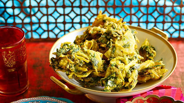 These crunchy fritters of onion, cauliflower, potato and spinach are served with a refreshing mint chutney. Serve as a part of an Indian banquet, or as a tasty bar snack.