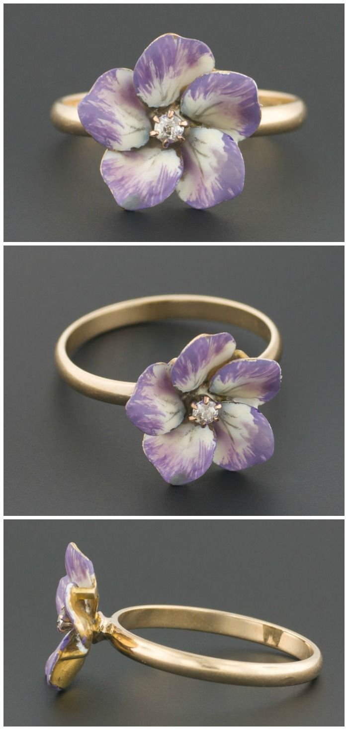 A ring made from a converted antique pin. The flower is lavender and white enamel, with a diamond center.