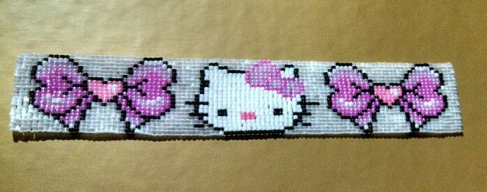 Hello Kitty bracelet Made with Delica 11/0 seed beads on a loom. By Raven Arcana