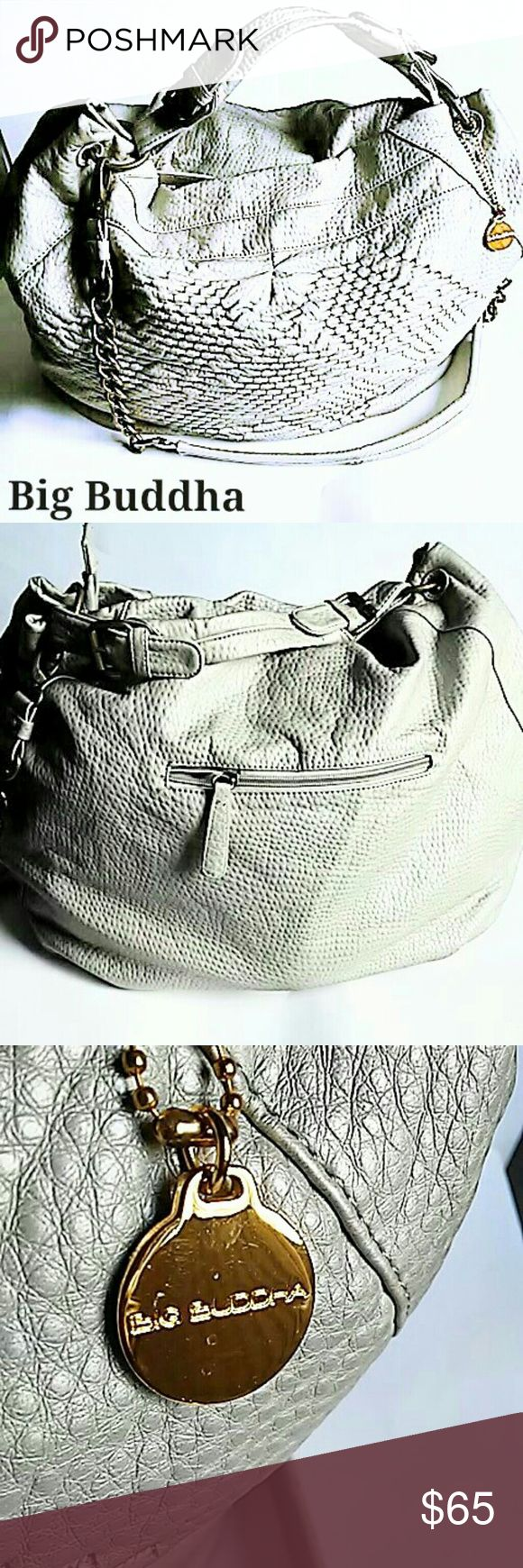 """GORGEOUS BIG BUDDHA BAG This Big Buddha Bag is like new and gorgeous!! Silver/light gray color. Only used a couple of times! Measurements are all approximate short strap 12"""", shoulder strap 37"""", overall bag 19 x 15, top to bottom 14 1/2"""",  bottom 13 x 6 1/2. Zipper pocket on back with 5 inside pockets (2 of them zip) overall bag closure is a zipper. Brass colored hardware with gold tone Big Buddha charm. Best color & texture is pic 5. ASK ALL QUESTIONS B4 YOU BUY! Big Buddha Bags Shoulder…"""