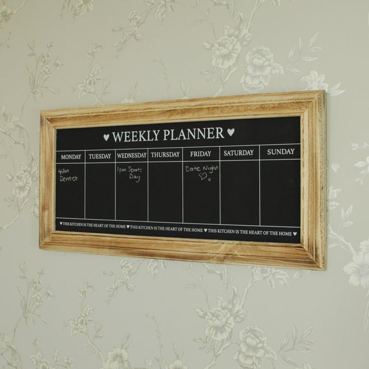 Days of the Week Chalkboard Organise your kitchen with this weekly planner With Monday to Sunday to plan and organise with the quote 'This Kitchen is the Heart of the Home' printed on the bottom With a wooden frame surrounding the chalkboard, this would suit a homely country kitchen With hooks on the back for wall hanging