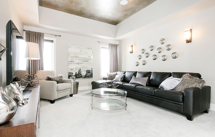 The neutral tones in this bonus room will give make any accent piece shine.