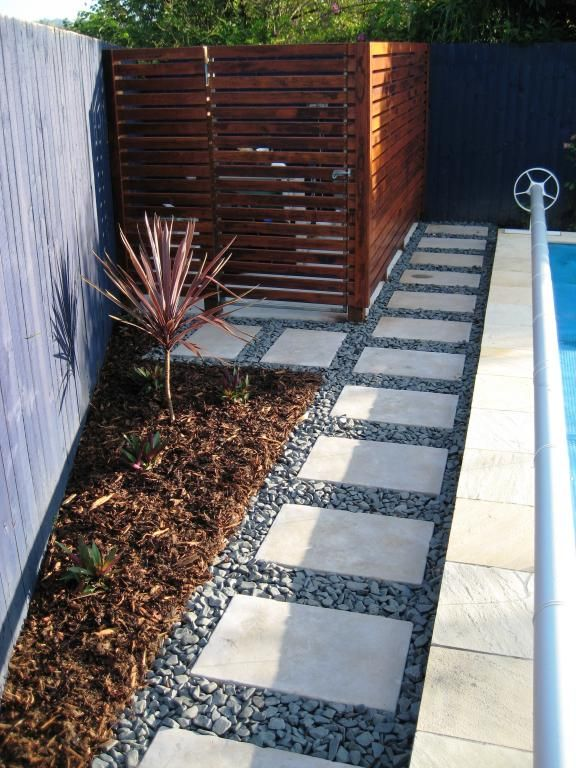 Would like to have a little paved walkway like this between backside of pool and holly trees