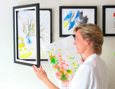 these clever art cabinet/frames. The frame/cabinet opens from the front and can hold 50 pieces of art.