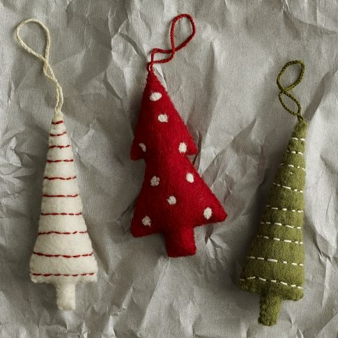 Precious. West Elm felt tree ornaments, $7 a pop. Definitely going to DIY