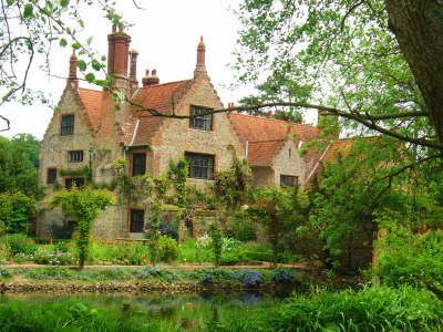 Hindringham Hall in Norfolk Tudor Manor House surrounded by 12th Century moat. Gardens: Three acres of peaceful gardens within and without the moat surrounding the house. Working walled vegetable garden, herb parterre, daffodil walk, bluebell and cyclamen copse, stream garden, bog garden, herbacious borders, autumn border, victorian nut tunnel, rose and clematis pergolas.