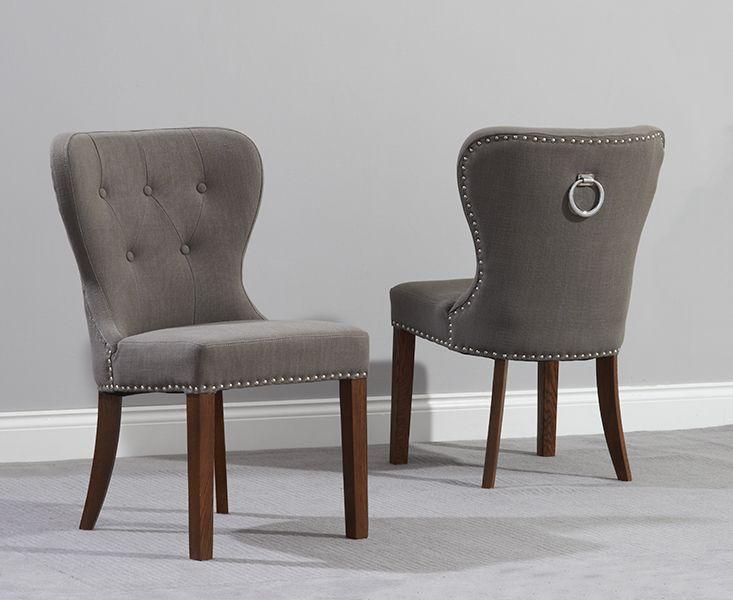 Buy the Knightsbridge Studded Grey Fabric Dark Oak Leg Dining Chairs at Oak Furniture Superstore