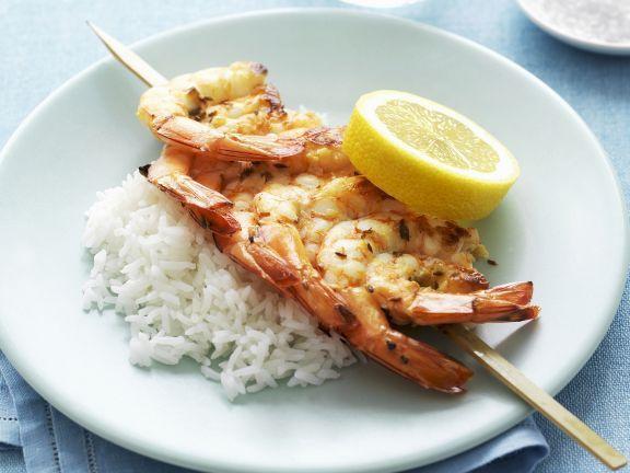 Probieren Sie die leckeren Zitronen-Knoblauch-Garnelen mit Reis von EAT SMARTER!