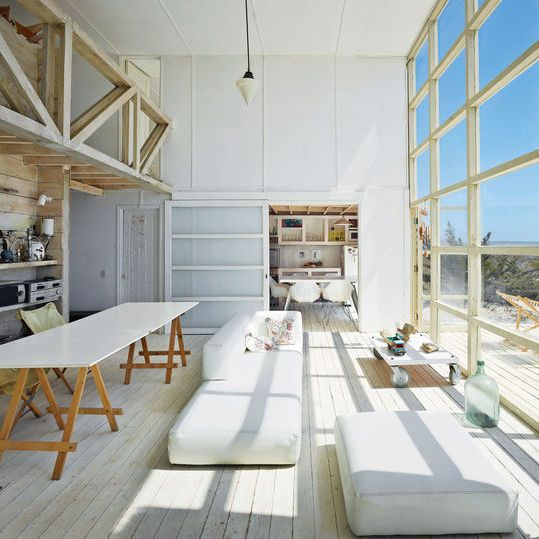 The structure of this vacation home in Chile is simple, but the double-height windows in the living room provide sweeping ocean views.