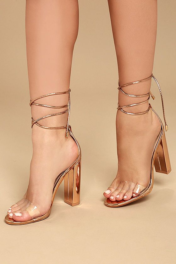 The Maricela Rose Gold Patent Lace-Up Heels satisfy your craving for an elegant look that's totally trend-worthy! Clear lucite forms a slender toe strap while vegan patent leather laces (finished with gold aglets) loop through a sturdy heel cup, then wrap and tie around the ankle.