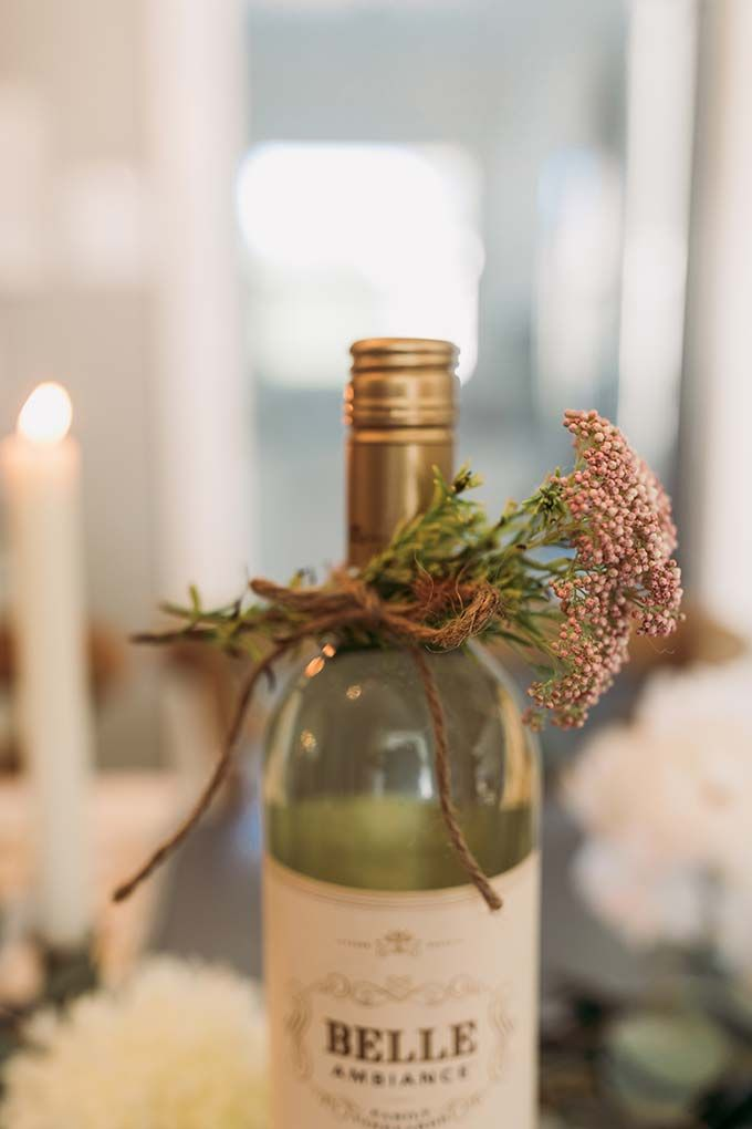 Inexpensive gift idea - add creative wrapping to a bottle of wine! Such an easy and inexpensive hostess gift idea! Click through for more wine gift ideas.