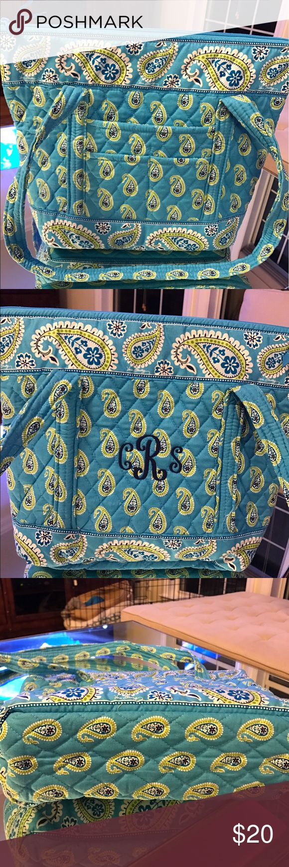 Vera Bradley Tote Bag Bermuda Blue Vera Bradley Tote bag in Bermuda Blue. One side of the Tote bag has my monogram in navy thread. There's probably a way to remove this, or can be worn on the other side! Inside there are multiple pockets, as well as pockets on the outside. The strap is long enough to fit over your shoulder. Please feel free to contact with any questions! Bag is in like new condition other than the monogram. Zippered top to close. Vera Bradley Bags Totes