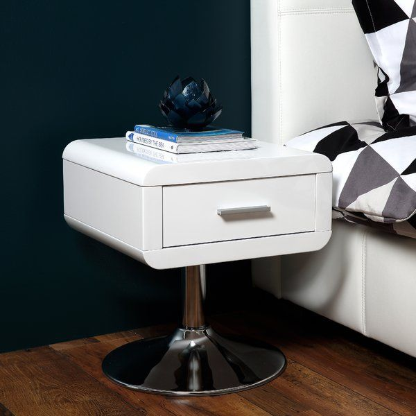 This white gloss bedside table sits neatly on its chrome base and will sit perfectly in any contemporary bedroom.