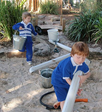 They removed all the toys from their sand pit and put in real tools and equipment that they could use!  I love this idea....I would include cooking tools as well.  I love the size of their sandpit as well as plants and bridges in it.