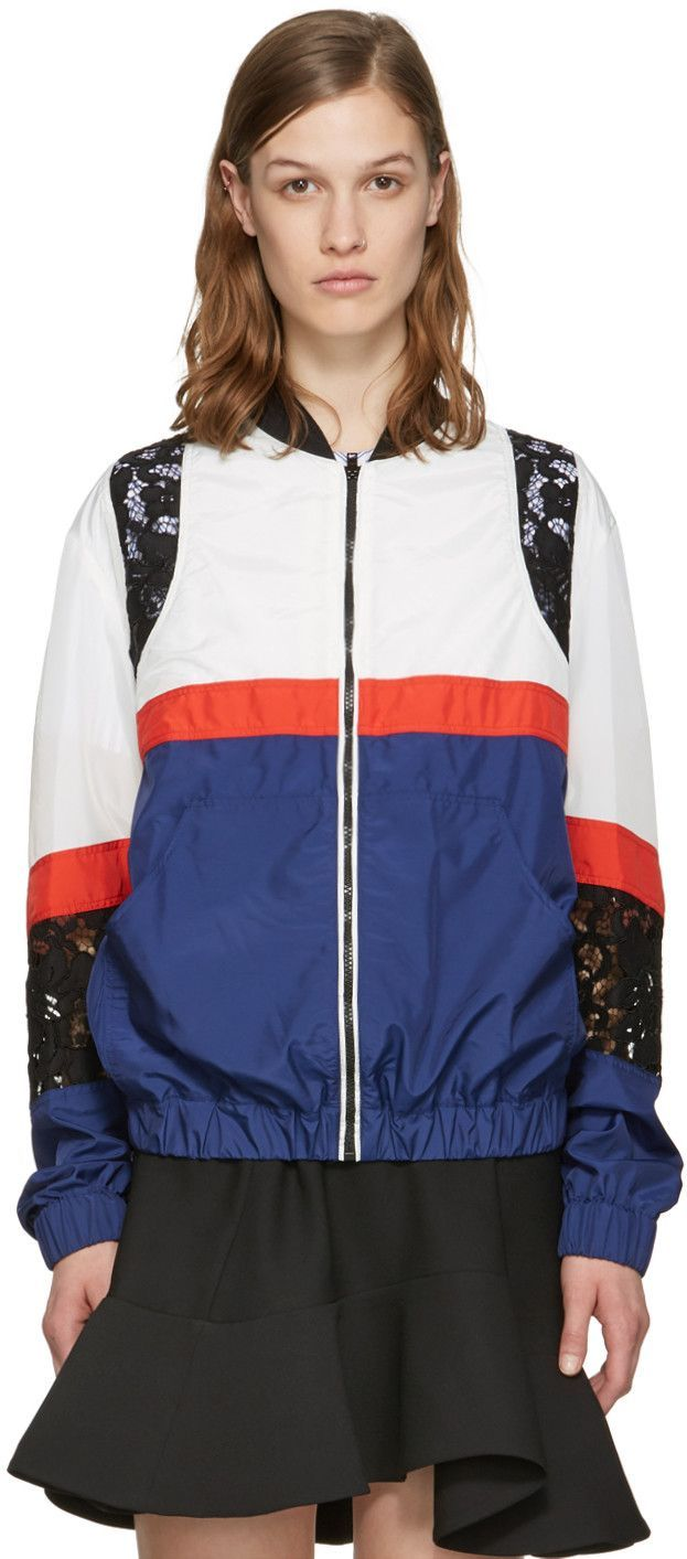 5a0248c904 Long sleeve 'parachute' nylon-blend bomber jacket panelled in blue, white,  and red. Rib knit stand collar in black. Zip closure at front.