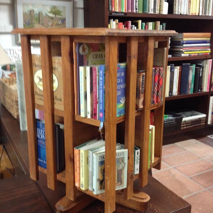 Small revolving bookcase with appealing small books.