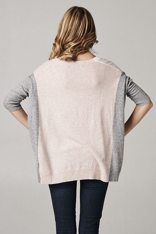 Take 2 sweaters. Cut the sides off one, and the middle out of the other. Stitch 'em up!