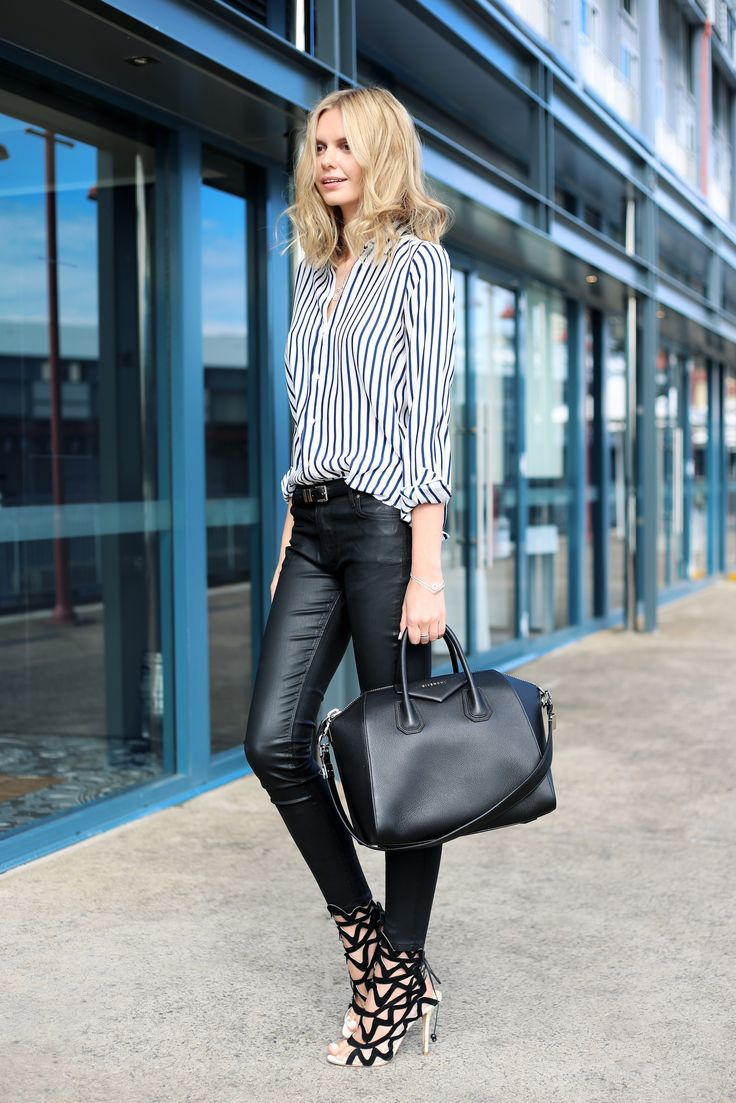 More black and white, this featuring a big trend for the fall: leather (or at least leather-like) pants, especially ones with moto details. You can approximate this look, too, with dark jeans that have a waxed finish.