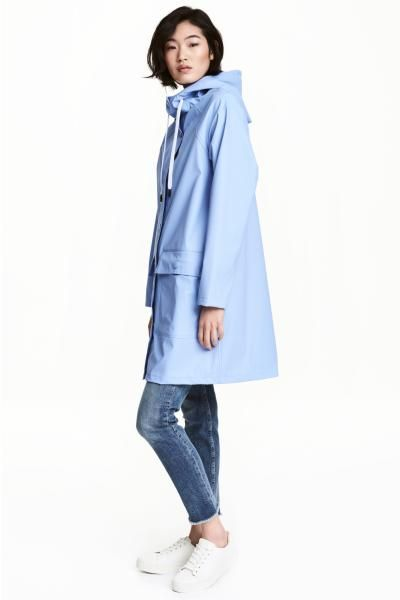 Rain coat with a hood: Rain coat with welded seams, a drawstring hood, press-studs down the front and patch front pockets with a flap and press-stud. Unlined.