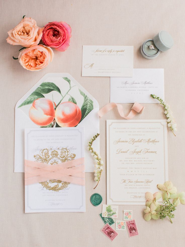 Peach wedding suite invitation flatlay | Photography: Koman Photography