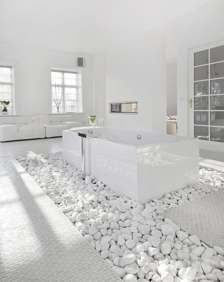 Total whiteout -- white rocks, white floors, white walls and smooth surfaces creating the ultimate luxurious feeling.