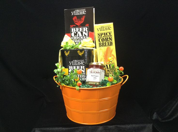 Summer themed in a mini ice bucket there is Beer Can Chicken spices, ceramic holder for the chicken ,cornbread mix and red pepper jelly! Open and serve! And don't forget the beer!
