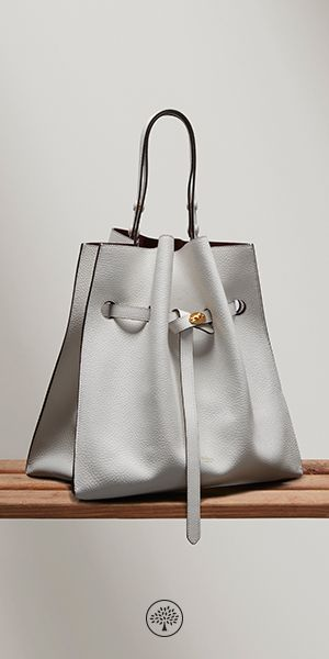 Shop the Tyndale in White Leather at Mulberry.com. The Tyndale is a soft, handheld bucket-shaped bag, drawn in through a refined leather belt. Its original geometric shape makes this a statement handbag, while its classic style has a timeless appeal. The Tyndale has been given a vibrant flash of colour via its contrasting suede lining.